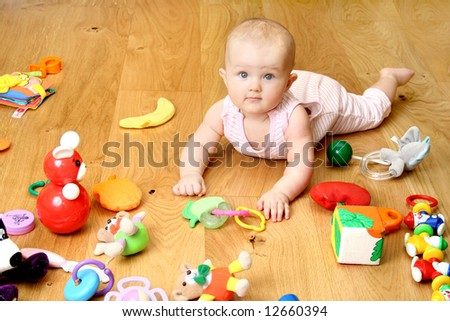 baby playing with a toys (girl 6 month) - stock photo