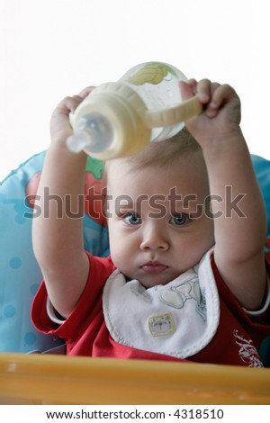 baby playing with bottle - stock photo