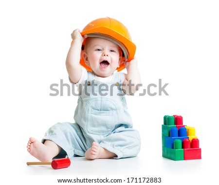 baby playing with building blocks toy - stock photo