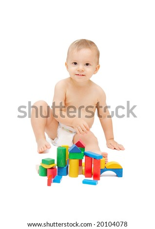 baby playing with color blocks, focus on the baby - stock photo