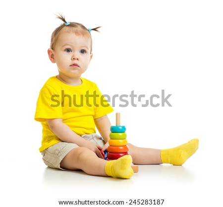baby playing with colorful wood pyramid isolated - stock photo