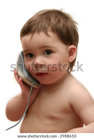 Baby playing with computer mouse as if it were a phone. Isolated on white. - stock photo