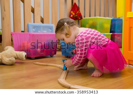 Baby playing with toys - stock photo