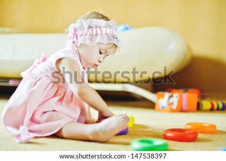 baby playing with toys at home - stock photo