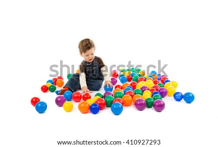 baby plays with color balls - stock photo