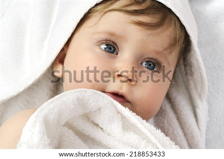 baby portrait with towel after bath  - stock photo