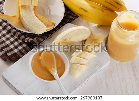 Baby puree in a jar with bananas. Selective focus - stock photo
