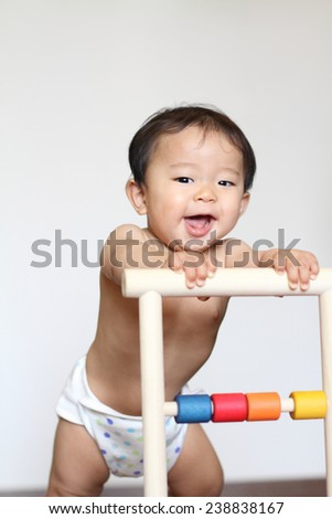 Baby pushing a cart (Japanese boy) - stock photo