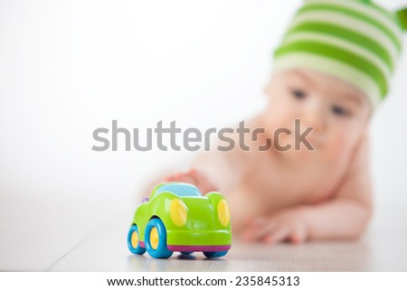 baby reaches his hand to the car - stock photo