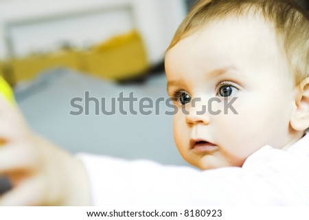 Baby  - reaching for something - stock photo