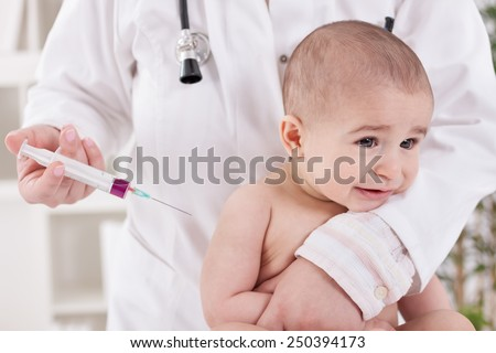 Baby receiving vaccine in lab - stock photo