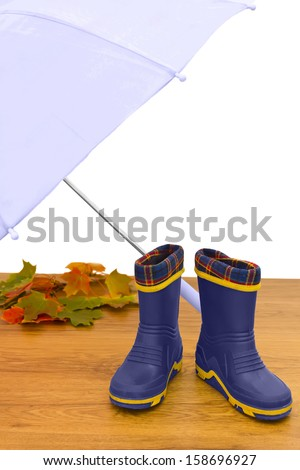 Baby rubber boots umbrella maple leaves floor isolated white background - stock photo