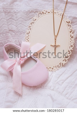 Baby shoe and card with golden cross for Christening - stock photo