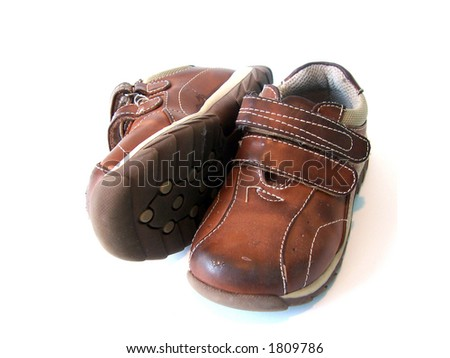 Baby shoes as worn by little children - stock photo