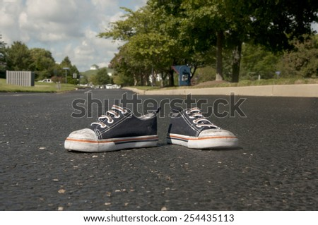 Baby Shoes in Road - stock photo