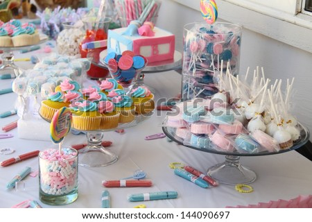 Baby shower and sweets on the table - stock photo