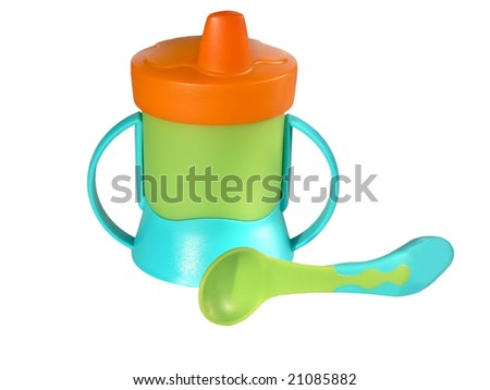 Baby sippy and spoon isolated on white background - stock photo