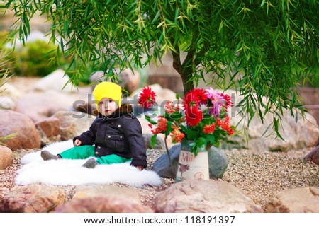 baby sitting in the park - stock photo