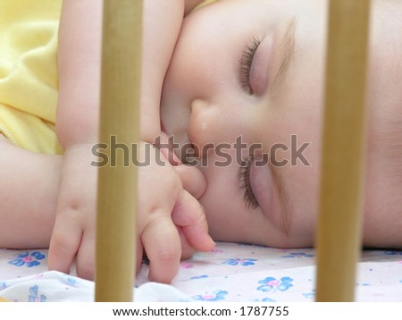 baby sleep in bed - stock photo