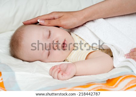 baby sleep under a blanket - stock photo