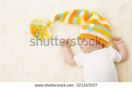 Baby Sleeping in Hat, New Born Kid Sleep in Bad, Newborn One Month Old - stock photo