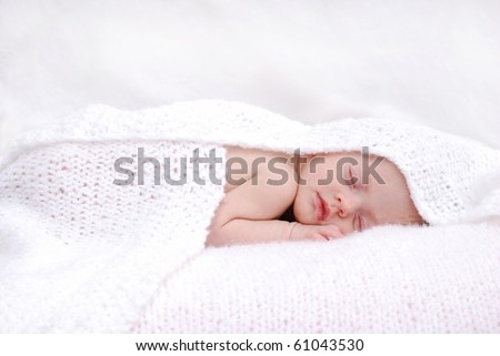 baby sleeping with blanket - stock photo