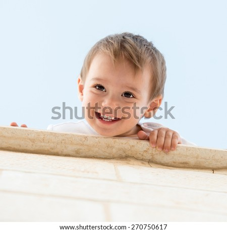 Baby smiling outdoor - stock photo