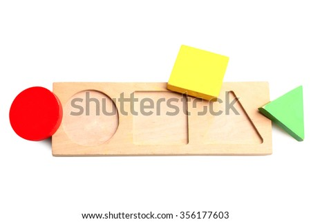 Baby sorter with geometric figures from wood on a white isolated background - stock photo