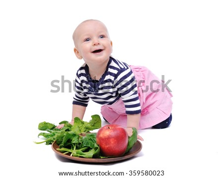 baby spinach tastes/charming baby spinach tastes; Isolated over White Background - stock photo