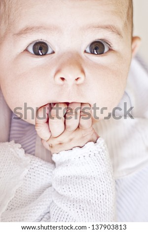 baby sucking fingers - stock photo