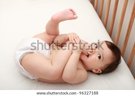 Baby sucking his toes - stock photo
