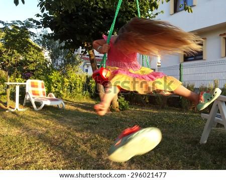 baby swing in garden - stock photo
