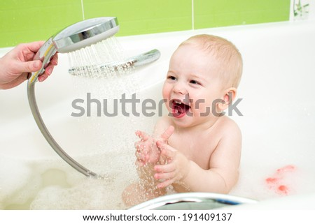 baby taking bath and douche - stock photo