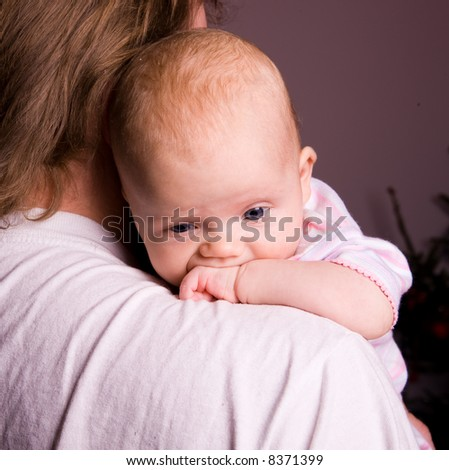 Baby thinking about problems - stock photo