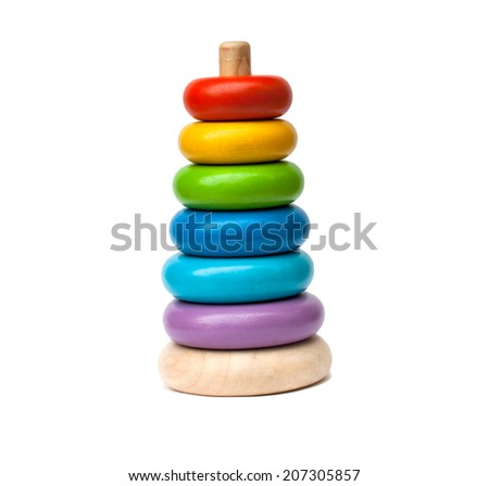 Baby toy. Learning child wood color pyramid toy - stock photo