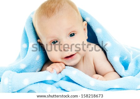baby under a blue blanket - stock photo