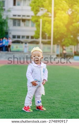 baby walking on playground - stock photo