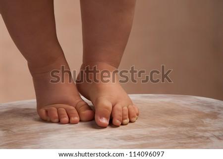 baby walking on wood floor - stock photo