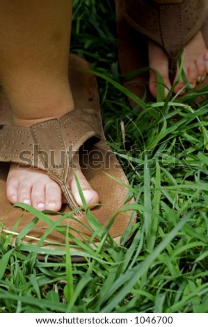 baby wearing a pair of thongs - stock photo