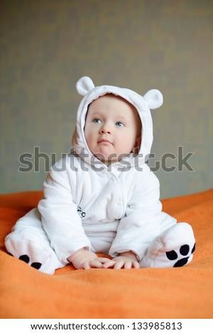 baby wearing costume of polar bear - stock photo
