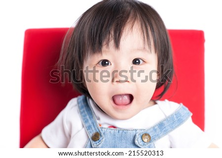 baby with a funny expression on her face - stock photo