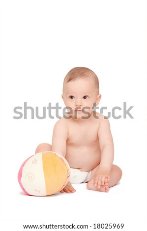 baby with ball sitting on the floor - stock photo
