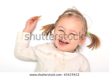 Baby with biscuit - stock photo