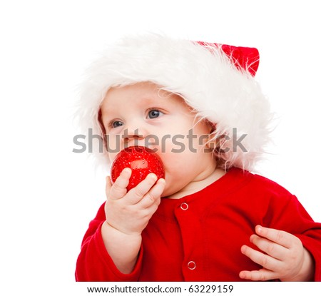 Baby with Christmas decoration in hand - stock photo