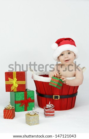 Baby with gifts in basket - stock photo