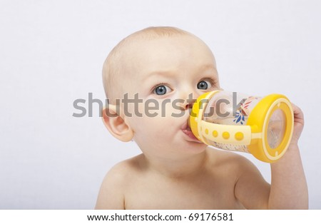 baby with her baby bottle - stock photo