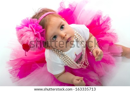 Baby with her birthday outfit - stock photo