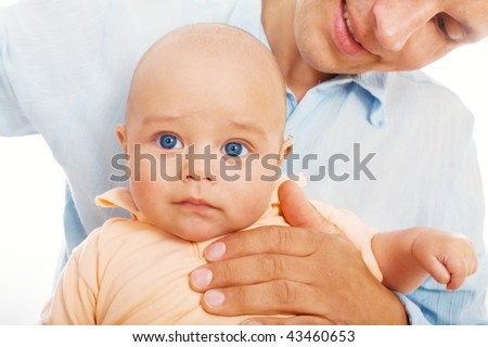 Baby with his daddy - stock photo