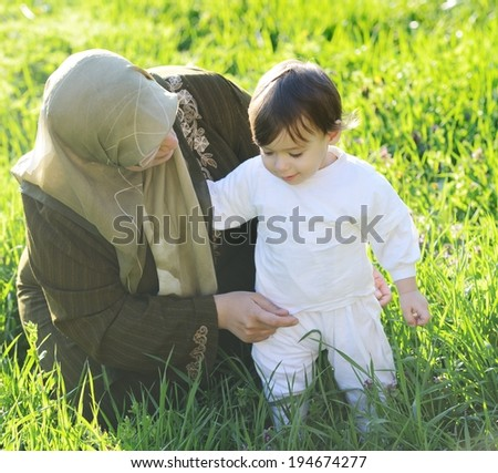 Baby with mother - stock photo