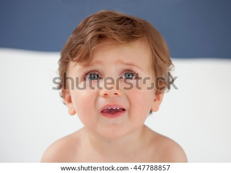 Baby with one years old with blue eyes looking up - stock photo